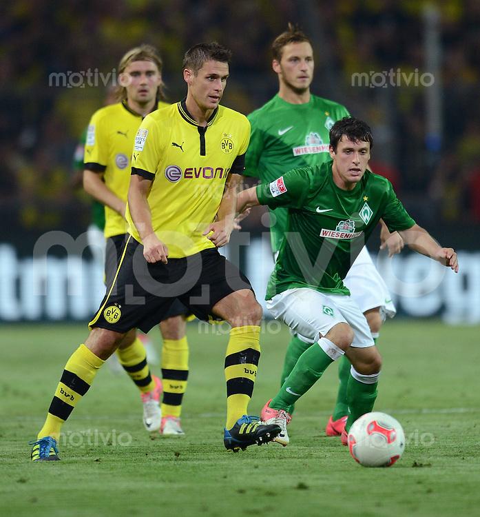 FUSSBALL   1. BUNDESLIGA   SAISON 2012/2013   1. SPIELTAG Borussia Dortmund - SV Werder Bremen                  24.08.2012      Sebastian Kehl (li, Borussia Dortmund) gegen Zlatko Junuzovic (re, SV Werder Bremen)