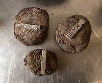 BNPS.co.uk (01202 558833)<br /> Pic: PhilYeomans/BNPS<br /> <br /> 32 and 24lb gun barrell 'wads' haves also been recovered along with their wooden markers.<br /> <br /> Fascinating artefacts salvaged from a historic gun ship which sunk off the British coast 261 years ago have gone on display for the first time.<br /> <br /> The French built ship is credited with transforming the Georgian Royal Navy after its capture in 1747 when trials revealed it was sleeker and better armed than British warships of the day.<br /> <br /> Unfortunately HMS Invincible  became wrecked on a shallow sand bank in the Solent in 1758 when en route to fhelp fight the French in Canada.<br /> <br /> The wreck, which is three nautical miles from Portsmouth, Hants, was first discovered by a fisherman in shallow 25ft waters 40 years ago. However, changing sea bed levels in the past few years have left it more exposed to the elements, leading to fears the relics could deteriorate.<br /> <br /> This prompted archaeologists to carry out a full scale excavation, with 1,458 dives taking place between 2017 and 2019 - during which nearly 2,000 artefacts were recovered.<br /> <br /> The array of new finds, including the ship's enormous cutwater - the forward curve of the ship's stem - have now been unveiled at the MAST Archaeological Centre in Poole, Dorset. They will eventually go on display at the National Museum of the Royal Navy in Portsmouth.<br /> <br /> Mr Pascoe said the HMS Invincible's innovative longer, streamlined design was copied by the British who adopted it on their ships up until the Battle of Trafalgar (1805).