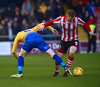 Lincoln City's Michael O'Connor vies for possession with  Mansfield Town's Neal Bishop<br /> <br /> Photographer Andrew Vaughan/CameraSport<br /> <br /> The EFL Sky Bet League Two - Lincoln City v Mansfield Town - Saturday 24th November 2018 - Sincil Bank - Lincoln<br /> <br /> World Copyright &copy; 2018 CameraSport. All rights reserved. 43 Linden Ave. Countesthorpe. Leicester. England. LE8 5PG - Tel: +44 (0) 116 277 4147 - admin@camerasport.com - www.camerasport.com