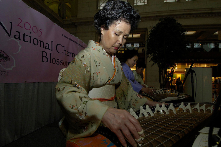 Sachilco Smith, Yoshiko Tucker and Kyoko Okamoto members of the Washington Toho Koto Society play Japanese koto music at Union Station. The Station was host to the National Cherry Blossom Festival's Cultural Performances in the West Hall.