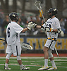 Mike Venezia #6, Massapequa goalie, left, and defenseman Brian Leneghan #33 celebrate after the offense scored a goal in the second quarter of a Nassau County varsity boys lacrosse game against Farmingdale at Massapequa High School on Friday, April 27, 2018. Massapequa won by a score of 7-4.