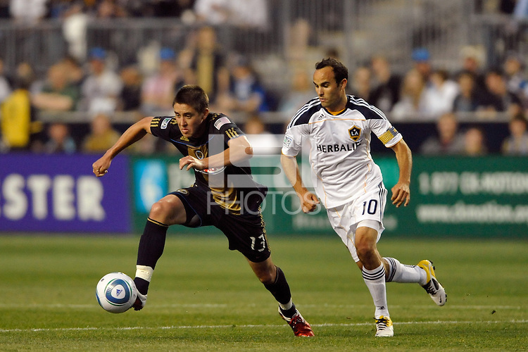 Kyle Nakazawa (13) of the Philadelphia Union is chased by Landon Donovan (10) of the Los Angeles Galaxy. The Philadelphia Union  and the Los Angeles Galaxy played to a 1-1 tie during a Major League Soccer (MLS) match at PPL Park in Chester, PA, on May 11, 2011.