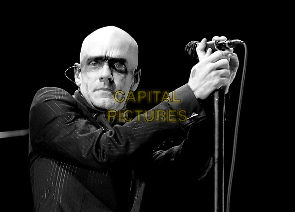 """MICHEL STIPE OF R.E.M..Performs live in support of their """"Around the World Tour"""" at Verizon Wireless Ampitheatre in Irvine, California, USA, October 16th 2004..half length concert music on stage live gig stripe mark on face make-up.Ref: DVS.www.capitalpictures.com.sales@capitalpictures.com.©Capital Pictures."""