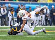 Morgantown, WV - November 18, 2017: Texas Longhorns running back Kyle Porter (21) gets tackled by West Virginia Mountaineers safety Kenny Robinson (2) during game between Texas and WVU at  Mountaineer Field at Milan Puskar Stadium in Morgantown, WV.  (Photo by Elliott Brown/Media Images International)