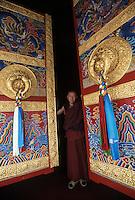 Tibet,Kham<br /> Monk a monastery doors of new stupa in Kandze.