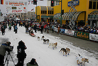 Aaron Burmeister leaves the start line in Anchorage on Saturday March 1st during the ceremonial start day of the 2008 Iidtarod Sled Dog Race.