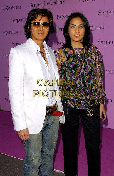 ANDY & PATTI WONG.The Serpentine Gallery Summer Party, London, UK..July 11th, 2006.Ref: CAN.half length white suit jacket sunglasses sahdes purple yellow green top.www.capitalpictures.com.sales@capitalpictures.com.©Capital Pictures