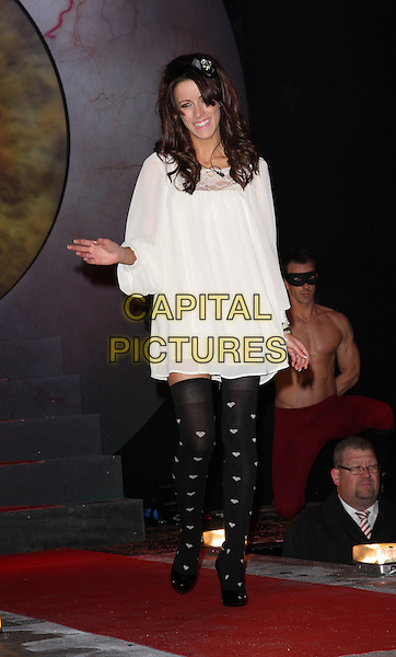 NICOLA T aka Nicola Tappenden.Contestants enter the House on the Opening Night of Celebrity Big Brother, Elstree Studios, London, England, UK, .January 3rd 2010.CBB BB full length white cream tunic smock dress heart print black otk over the knee high socks hand waving .CAP/ROS.©Steve Ross/Capital Pictures