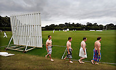 Scottish National Cricket League - Premier Div - Uddingston CC V Aberdeenshire at Bothwell Policies, Uddingston - if ever there was need of a sight screen ... members of Uddingston's rugby section make their way to from the showers to their cabin after a training session, as the cricket match rages on in the distance - Picture by Donald MacLeod 24.07.10 - mobile 07702 319 738 - clanmacleod@btinternet.com