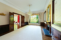 BNPS.co.uk (01202 558833)<br /> Pic: AndyScott/Savills/BNPS<br /> <br /> PICTURED: There's are five reception rooms to entertain guests<br /> <br /> A stunning castellated mansion has emerged for sale for £3.75.<br /> <br /> Grade II-listed Worth Hall near Crawley, West Sussex, dates back to the 1840s and is the perfect home for living a luxurious family life.<br /> <br /> It has seven bedrooms, seven bathrooms and five reception areas as well as a billiards room, a cinema and a swimming pool.