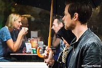 Nederland, Utrecht, 11 okt  2014<br /> Utrecht met slecht weer en regen. Veel paraplu's op straat en mensen die in een cafe wat warms drinken.<br /> Het winkelend publiek laat zich niet afhouden van een dagje shoppen<br /> Foto: (c) Michiel Wijnbergh