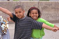 Siblings age 9 and 7 celebrating at Cinco de Mayo Festival.  St Paul  Minnesota USA