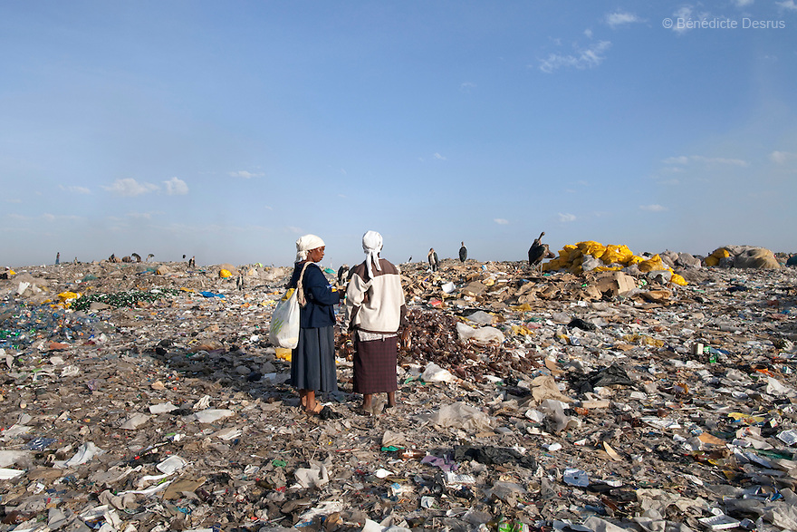 13 february 2013 - Dandora dumpsite, Nairobi, Kenya - Kenyan women at the Dandora dumpsite, one of the largest and most toxic in Africa. Located near slums in the east of the Kenyan capital Nairobi, the open dump site was created in 1975 and covers 30 acres. The site receives 2,000 tonnes of unfiltered garbage daily, including hazardous chemical and hospital wastes. It is a source of survival for many people living in the surrounding slums, however it also harms children and adults' health in the area and pollutes the Kenyan capital. Photo credit: Benedicte Desrus