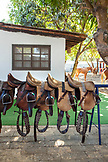 MEXICO, San Pancho, San Francisco, La Patrona Polo Club, saddles lined up in the stables