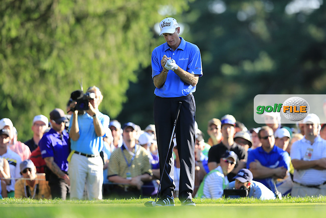 Jim Furyk (USA) marks his ball on the 18th tee during Sunday's Final Round of the 95th US PGA Championship 2013 held at Oak Hills Country Club, Rochester, New York.<br /> 11th August 2013.<br /> Picture: Eoin Clarke www.golffile.ie