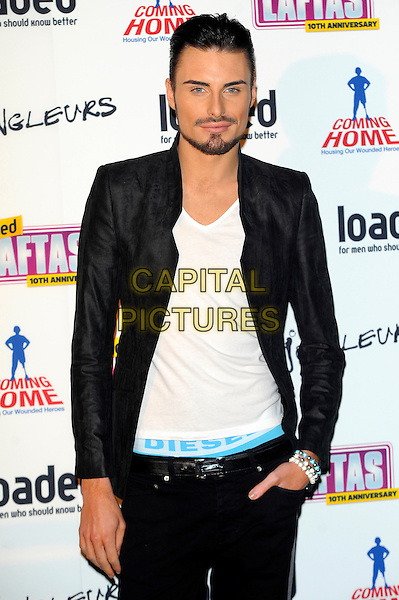 Rylan Clark.The Loaded Lafta's at Sway, London, England..March 7th, 2013.half length black suit jacket white top beard facial hair diesel elastic waist hand in pocket jeans denim blue .CAP/CJ.©Chris Joseph/Capital Pictures.