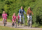 HRH Prince Willem-Alexander (2ndR) and his wife Princess Maxima and their daughters Amalia (L) , Ariane (C) and Alexia (2ndL) arrive by bicycle to pose for the annual summer photocall in Wassenaar July 7, 2012. REUTERS/Michael Kooren. (NETHERLANDS)