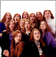 Group of red haired women looking up