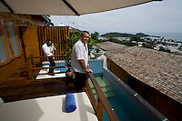 Rabbi Goldshmid walks down to the plunge pool with his daughter as Yossi (right) poses for a portrait in his plush holiday resort, KC Resort & Over Water Villas, that is to have its grand launch next month. Yossi has lived in Koh Samui with his wife and 2 kids for 5 years and has been building this resort for the last 3 years, with the interior designs done by an Israeli designer. He sends his children to Sunday school with Rabbi Goldshmid's wife, Sara..Photo by Suzanne Lee / For Chabad Lubavitch