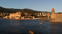 Eglise Notre Dame des Anges (left) and Chateau Royal (right), Collioure, France, against the backdrop of the mountains. Picture by Manuel Cohen.
