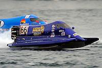 Dana Tomes (#66) and Jose Mendana, Jr. (#21)     (Formula 1/F1/Champ class)