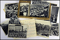 BNPS.co.uk (01202 558833)<br /> Pic: ChalkwellAuctions/BNPS<br /> <br /> The carefully orchestrated pictures show the Fuhrer as a popular man of the people.<br /> <br /> Found in a cardboard box...a meticulous account ofthe pre war rise of the cult of Hitler.<br /> <br /> An incredible picture archive that charts the rise of Hitler believed to have been meticulously documented by a fan of the Fuhrer has emerged for sale.<br /> <br /> The collection of propaganda photographs show Adolf Hitler on a charm offensive in the 1920s and 30s - before the evil dictator started the Second World War and eliminated at least five million Jews in the Holocaust.<br /> <br /> Some of the images try to show a softer side to the Nazi leader, with him feeding a small deer and accepting a bouquet from a young girl.<br /> <br /> Others chillingly show the hype created around him - rows of people performing the straight-arm Nazi salute, a young boy beaming as Hitler signs an autograph for him and a group of girls giggling as they chat to the party leader.