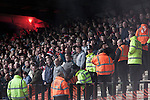 Police keep an eye on visiting supporters during the second-half at Key's Park during the Hednesford Town (in white) versus FC United of Manchester Northern Premier League premier division play-off final. The match would decide which club were promoted to the Blue Square Conference North. Hednesford won the game by 2 goals to 1 in front of a stadium record attendance of 4412 spectators.