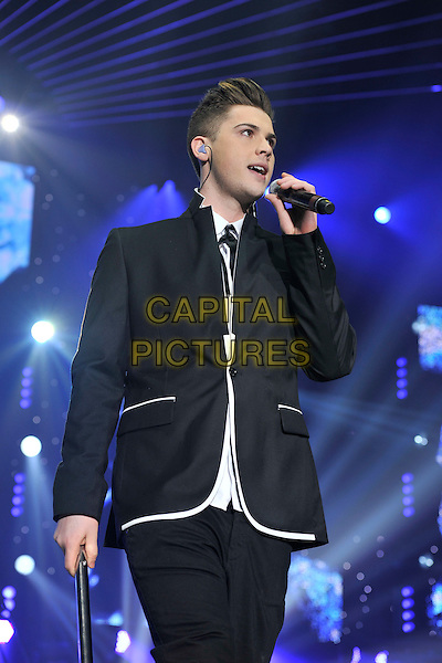 AIDEN GRIMSHAW .performs during The X Factor Live tour, Wembly Arena, London, England, .March 5th 2011..music concert gig on stage half length microphone singing black jacket white .CAP/MAR.© Martin Harris/Capital Pictures.