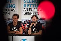 """Pressekonferenz der zivilen Seenotrettungsorganisation Sea-Watch am 2. Juli 2019 in Berlin, nachdem die Kapitaenin des Rettungsschiff """"Sea-Watch 3"""", Carola Rackete, in Italien festgenommen wurde. Die Kapitaenin hatte am 29. Juni gegen den Willen der italienischen Regierung auf der Mittelmeerinsel Lampedusa, mit 40 aus Seenot geretteten Fluechtlingen, im Hafen angelegt und war daraufhin festgenommen worden.<br /> Im Bild vlnr.: Marie Naass, politische Sprecherin von Sea-Watch; Ruben Neugebauer, Pressesprecher von Sea-Watch.<br /> 2.7.2019, Berlin<br /> Copyright: Christian-Ditsch.de<br /> [Inhaltsveraendernde Manipulation des Fotos nur nach ausdruecklicher Genehmigung des Fotografen. Vereinbarungen ueber Abtretung von Persoenlichkeitsrechten/Model Release der abgebildeten Person/Personen liegen nicht vor. NO MODEL RELEASE! Nur fuer Redaktionelle Zwecke. Don't publish without copyright Christian-Ditsch.de, Veroeffentlichung nur mit Fotografennennung, sowie gegen Honorar, MwSt. und Beleg. Konto: I N G - D i B a, IBAN DE58500105175400192269, BIC INGDDEFFXXX, Kontakt: post@christian-ditsch.de<br /> Bei der Bearbeitung der Dateiinformationen darf die Urheberkennzeichnung in den EXIF- und  IPTC-Daten nicht entfernt werden, diese sind in digitalen Medien nach §95c UrhG rechtlich geschuetzt. Der Urhebervermerk wird gemaess §13 UrhG verlangt.]"""