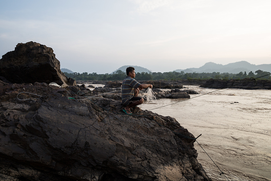 Oct. 10, 2016 - Don Sahong, Laos. A fisherman places his nets from the Mekong River near the Lipi waterfalls. © Nicolas Axelrod / Ruom