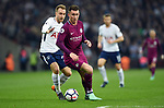 Christian Eriksen of Tottenham Hotspur is challenged by Aymeric Laporte of Manchester City during the premier league match at the Wembley Stadium, London. Picture date 14th April 2018. Picture credit should read: Robin Parker/Sportimage