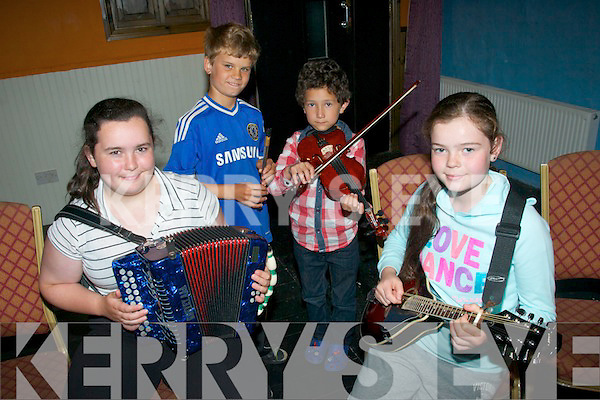 Comhaltas Ceoltoiri Eireann,Craobh Naomh Chiarain,rambling house took place in Brown's bar Castleisland last Friday evening the young musical players were L-R Siobhan Brosnan,Kirill Healy,Kieran Murphy&Caroline Hurley.