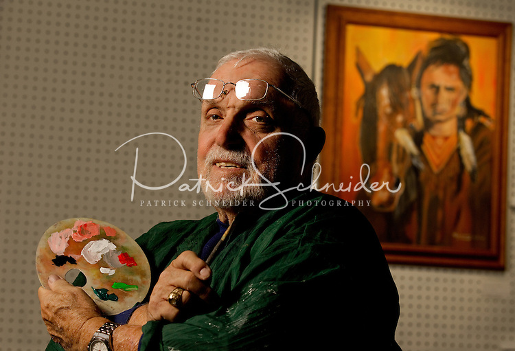 Photographic portrait of Painter Richard Tolbert, one of the many artists who can be found inside Gallery 21 Union at 21 Union Street South in downtown Concord, North Carolina. A combination art gallery and working artist studio, Gallery 21 Union is one of the many small-town finds that make Concord, NC, special. Photo is part of a photographic series of images featuring Concord, NC, by Charlotte-based photographer Patrick Schneider.