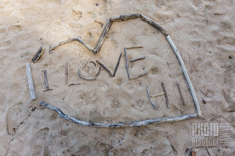 """I Love Hawai'i"" beach art spelled in driftwood and outlined with a heart, Kaua'i."
