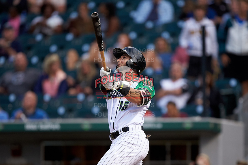 Paulo Orlando (16) of the Caballeros de Charlotte follows through on his swing against the Buffalo Bisons at BB&T BallPark on July 23, 2019 in Charlotte, North Carolina. The Bisons defeated the Caballeros 8-1. (Brian Westerholt/Four Seam Images)