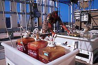 A marine biologist checks laboratory equipment.