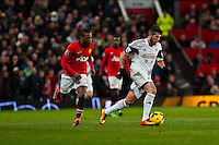 Saturday 11 January 2014 Pictured: Alejandro Pozuelo breaks forward for the swans <br /> Re: Barclays Premier League Manchester Utd v Swansea City FC  at Old Trafford, Manchester