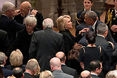 Former Secretary of State Hillary Clinton, second from right, greets former President Barack Obama, right, before a State Funeral for former President George H.W. Bush at the National Cathedral, Wednesday, Dec. 5, 2018, in Washington. Also pictured is former President Bill Clinton, left. <br /> Credit: Andrew Harnik / Pool via CNP
