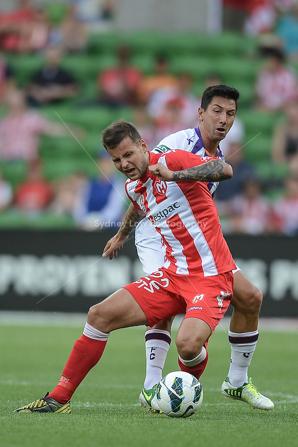 MELBOURNE - 8 DEC: Nick KALMAR of the Heart and Jacob BURNS of the Glory fight for the ball in the round ten A-League match between the Melbourne Heart and Perth Glory at AAMI Park on 8 December 2012. (Photo Sydney Low/syd-low.com/Melbourne Heart)