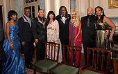 Members of the band Earth, Wind & Fire pose with their spouses, from left to right, Valerie Bailey, singer Philip Bailey, percussionist Ralph Johnson,  Susan Johnson, bassist Verdine White, and his wife, Shelly Clark, three of the recipients of the 42nd Annual Kennedy Center Honors, pose with Kahbran White, son of Maurice White and a guest following a dinner at the United States Department of State in Washington, D.C. on Saturday, December 7, 2019. The 2019 honorees are: Earth, Wind & Fire, Sally Field, Linda Ronstadt, Sesame Street, and Michael Tilson Thomas.<br /> Credit: Ron Sachs / Pool via CNP