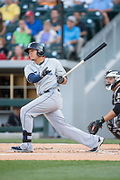 Giovanny Urshela (41) of the Columbus Clippers follows through on his swing against the Charlotte Knights at BB&T BallPark on May 27, 2015 in Charlotte, North Carolina.  The Clippers defeated the Knights 9-3.  (Brian Westerholt/Four Seam Images)