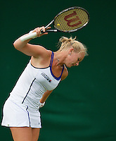 24-06-13, England, London,  AELTC, Wimbledon, Tennis, Wimbledon 2013, Day one, Kiki Bertens wants to throw her racket out of frustration<br /> <br /> <br /> <br /> Photo: Henk Koster