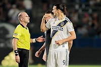 CARSON, CA - SEPTEMBER 15: Ted Unkel and Zlatan Ibrahimovic #9 of the Los Angeles Galaxy exchange a few words during a game between Sporting Kansas City and Los Angeles Galaxy at Dignity Health Sports Complex on September 15, 2019 in Carson, California.