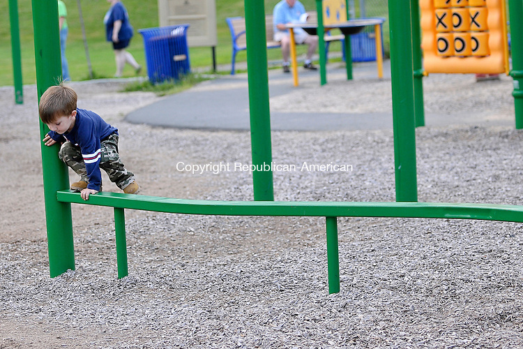 THOMASTON, CT - 27 August 2012-082712EC09--   Mason Andrew Miller Gomme, 3, of Plymouth, steadies himself as he tries to walk on the beam at the Thomaston high school playground Monday afternoon.  Erin Covey Republican American.