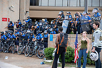 AUSTIN, TEXAS - MAY 30, Police officers close ranks and fire on the crowd of Black Lives Matter protesters with less lethal rounds at the Austin Police Department Headquarters on May 30, 2020 in Austin, Texas<br /> <br /> Use of this image in advertising or for promotional purposes is prohibited.<br /> <br /> Editorial Credit: Photo by Dan Herron / Herron Stock