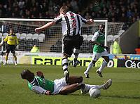 Isaiah Osbourne tackles David van Zanten in the St Mirren v Hibernian Clydesdale Bank Scottish Premier League match played at St Mirren Park, Paisley on 29.4.12.