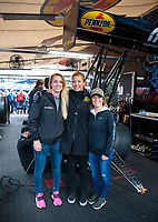 Mar 17, 2019; Gainesville, FL, USA; NHRA top fuel driver Leah Pritchett (center) with guests in the pits during the Gatornationals at Gainesville Raceway. Mandatory Credit: Mark J. Rebilas-USA TODAY Sports