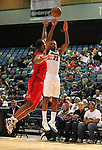 Reno Bighorns Zach Graham shoots over an Idaho Stampede defender during a basketball game Sunday, April 1, 2012 in Reno, Nev. Idaho won 108-99..Photo by Cathleen Allison