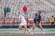 College Park, MD - February 25, 2017: Maryland Terrapins Kali Hartshorn (16) wins the faceoff during game between North Carolina and Maryland at  Capital One Field at Maryland Stadium in College Park, MD.  (Photo by Elliott Brown/Media Images International)