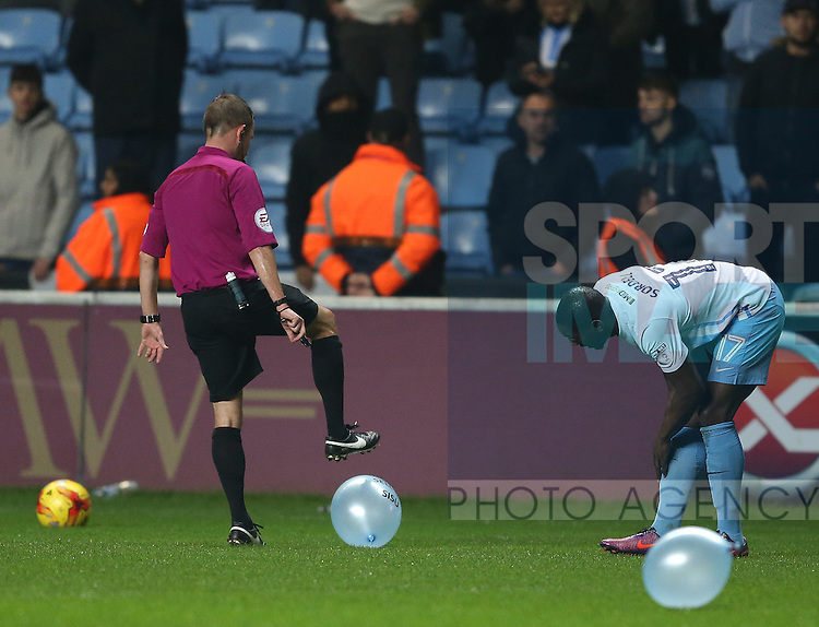 Referee David Webb burst balloons during the English League One match at the Rioch Arena Stadium, Coventry. Picture date: December 15th, 2016. Pic Simon Bellis/Sportimage